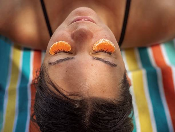 Close-Up Portrait Of Woman Relaxing At Beach