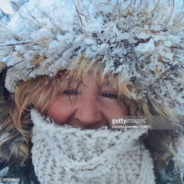 Close-Up Portrait Of Woman Wearing Fur Hat During Winter