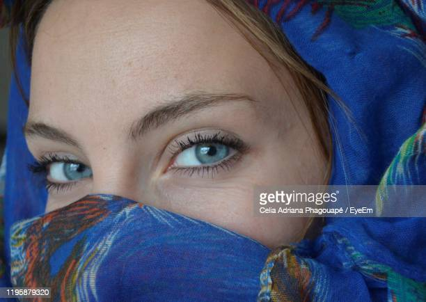 close-up portrait of woman wearing headscarf - gray eyes stock pictures, royalty-free photos & images