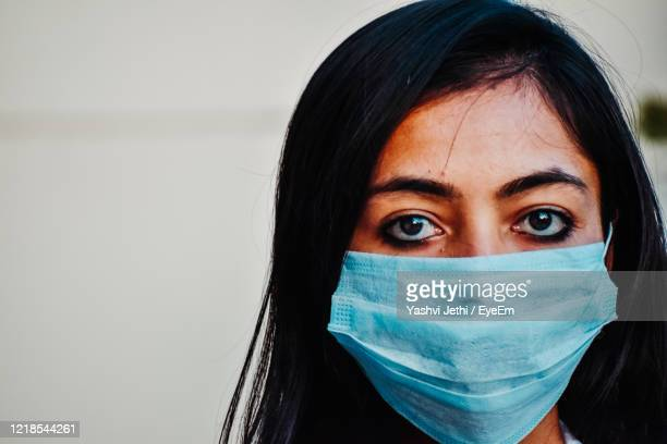 close-up portrait of woman wearing mask - india stock pictures, royalty-free photos & images
