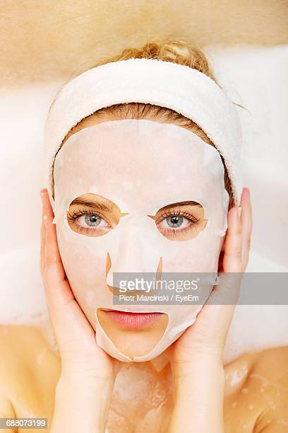 close-up portrait of woman wearing mask - face masks imagens e fotografias de stock