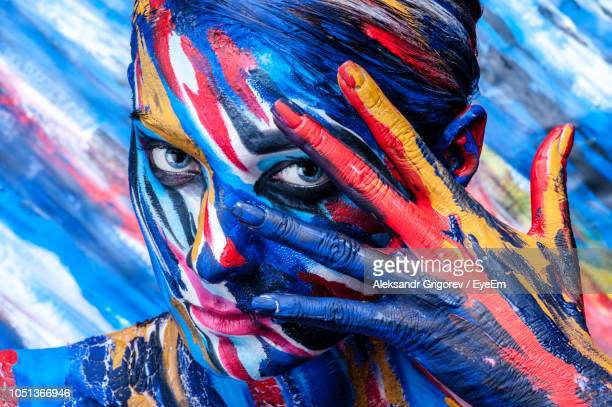 close-up portrait of woman with body paint - body paint stock pictures, royalty-free photos & images