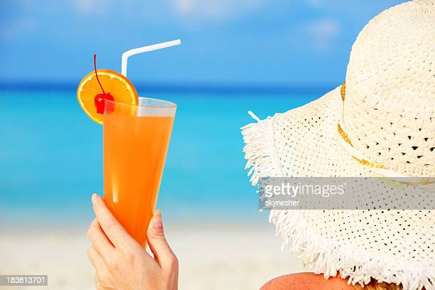 Closeup portrait of woman with cocktail on beach
