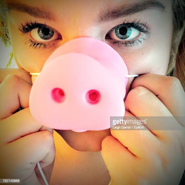 close-up portrait of woman with pig mask - nose mask stock pictures, royalty-free photos & images