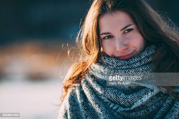 Close-up portrait of young beautiful woman during winter
