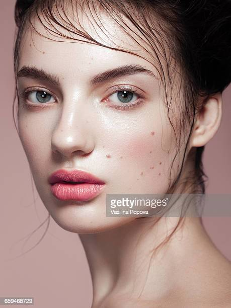 close-up portrait of young beautiful woman - mole stock photos and pictures