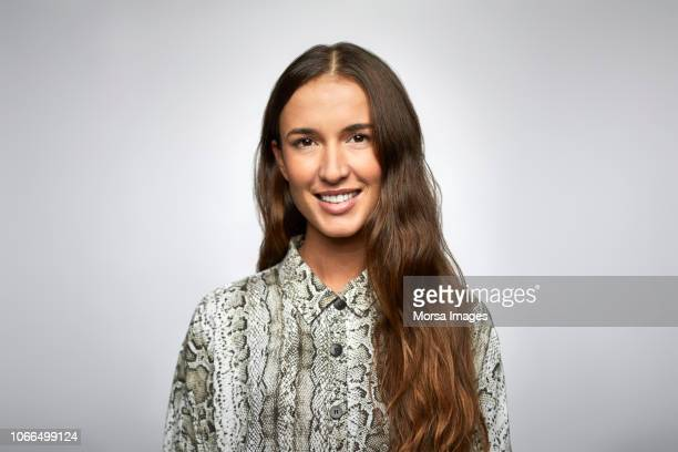 close-up portrait of young businesswoman smiling - brown hair stock pictures, royalty-free photos & images
