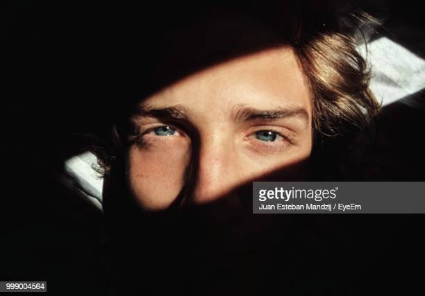 close-up portrait of young man in darkroom - latin america stock pictures, royalty-free photos & images