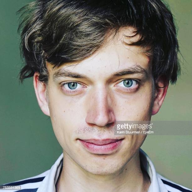 close-up portrait of young man - blue eyes stock pictures, royalty-free photos & images