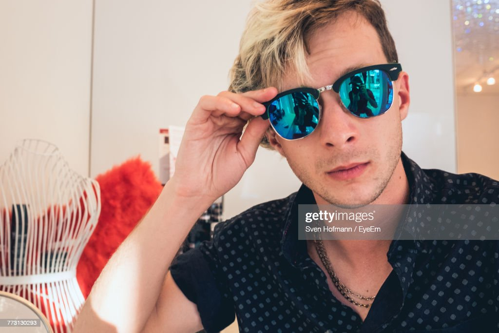 Close-Up Portrait Of Young Man Wearing Sunglasses : Photo