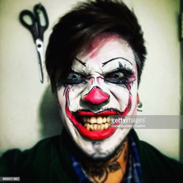 close-up portrait of young man with face paint at home - scary clown makeup stock photos and pictures