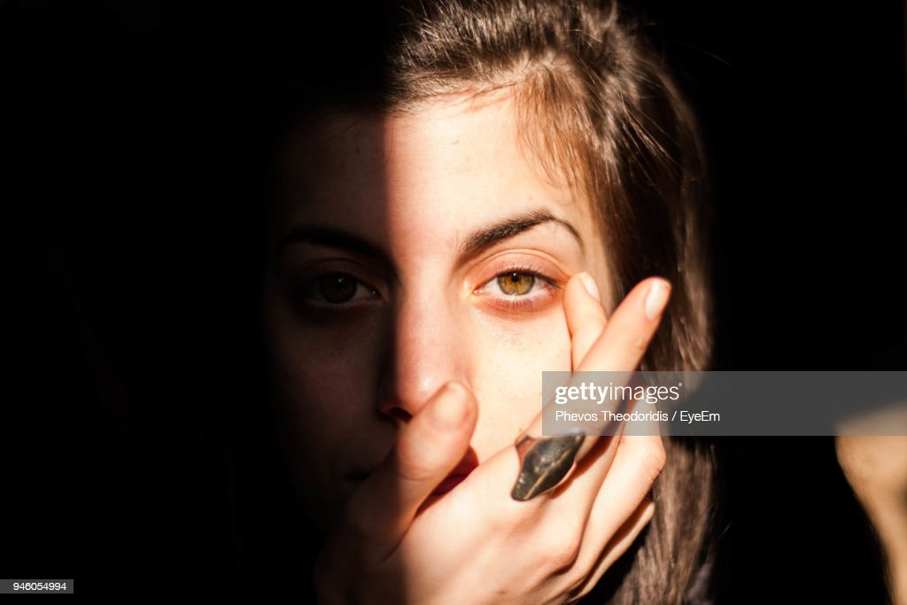 Close-Up Portrait Of Young Woman Against Black Background : Stock Photo