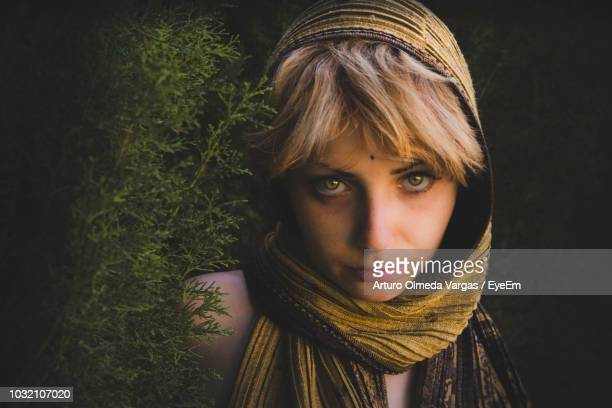 close-up portrait of young woman against wall - neckwear stock pictures, royalty-free photos & images