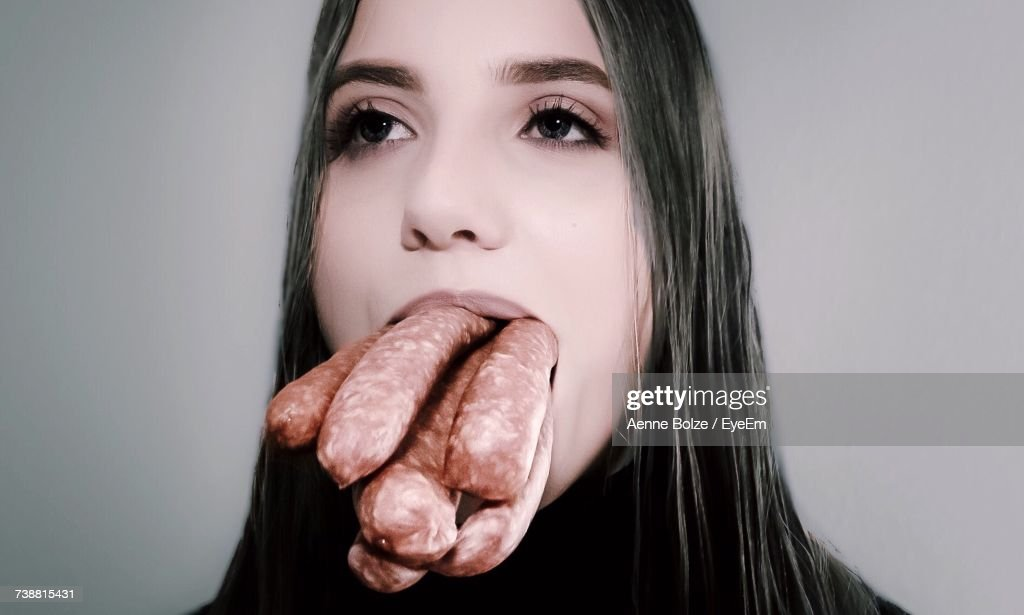 Close-Up Portrait Of Young Woman Eating Food : Stock Photo
