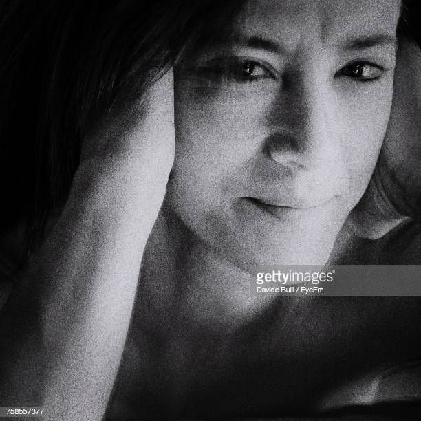 Close-Up Portrait Of Young Woman In Darkroom