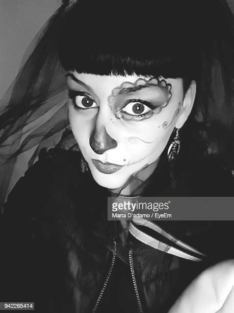 close-up portrait of young woman in halloween costume - adamo photos et images de collection