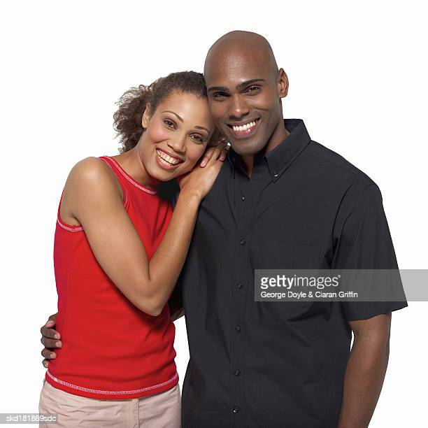 close-up portrait of young woman leaning on young man's shoulder - arm around stock pictures, royalty-free photos & images