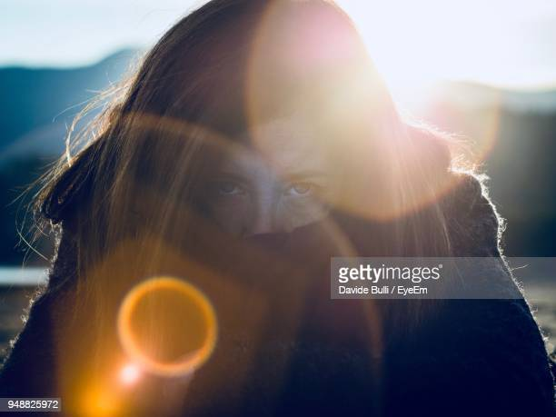 Close-Up Portrait Of Young Woman On Sunny Day