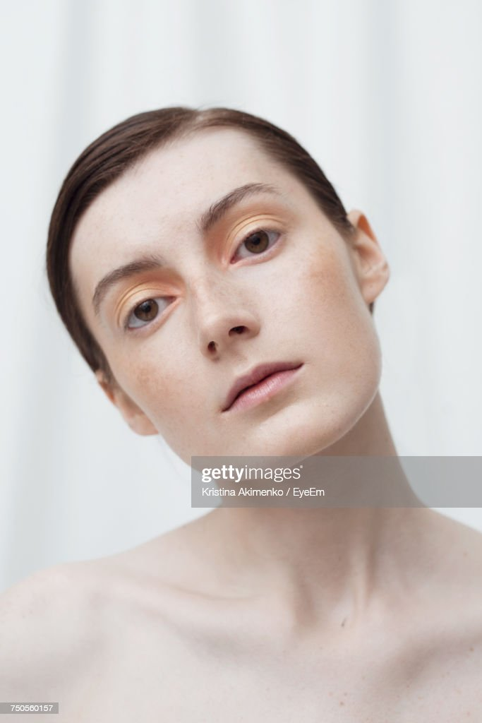 Close-Up Portrait Of Young Woman Over White Background : Stock Photo