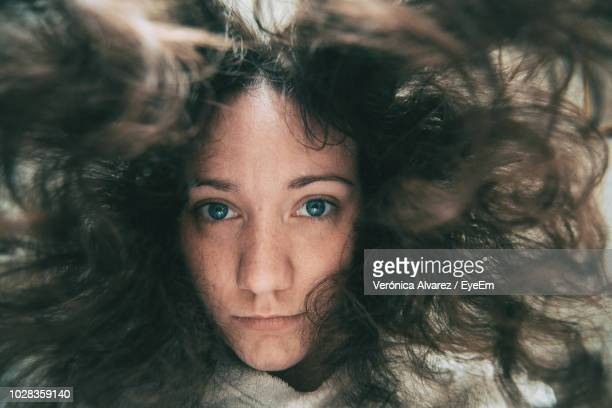 close-up portrait of young woman - below stock pictures, royalty-free photos & images