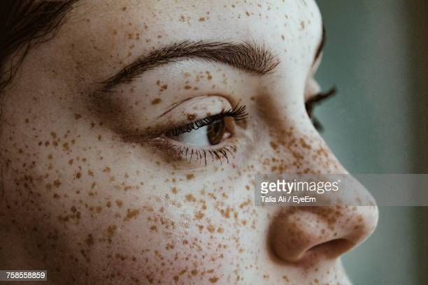 close-up portrait of young woman - human skin stock pictures, royalty-free photos & images