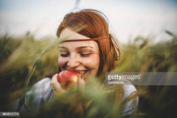 close-up portrait of young woman - apple fruit stock photos and pictures