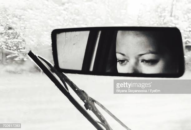 Close-Up Portrait Of Young Woman Sitting In Car
