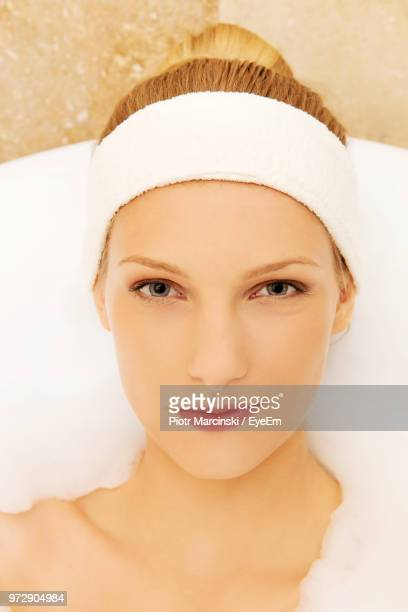 Close-Up Portrait Of Young Woman Taking Bath In Bathtub