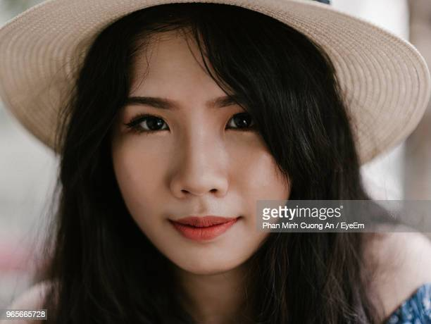 Close-Up Portrait Of Young Woman Wearing Hat