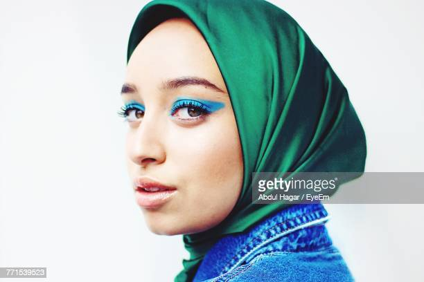 Close-Up Portrait Of Young Woman Wearing Hijab Against White Background