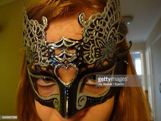 Close-Up Portrait Of Young Woman Wearing Mask At Home
