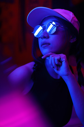 Close-Up Portrait Of Young Woman Wearing Sunglasses In Darkroom - gettyimageskorea