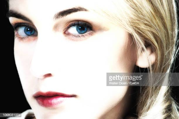 Close-Up Portrait Of Young Woman With Blue Eyes