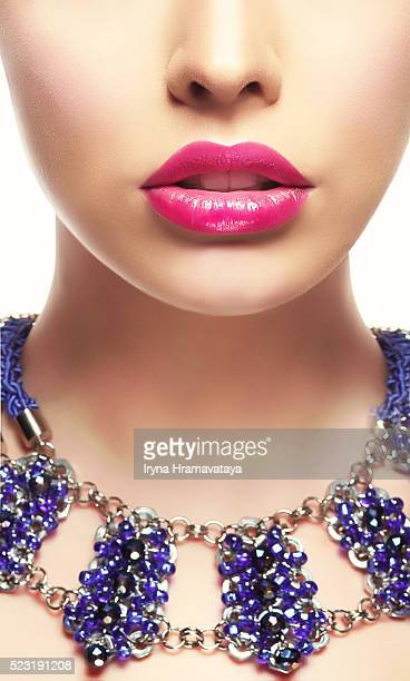 Close-up Portrait of Young Woman with Bright Lipstick