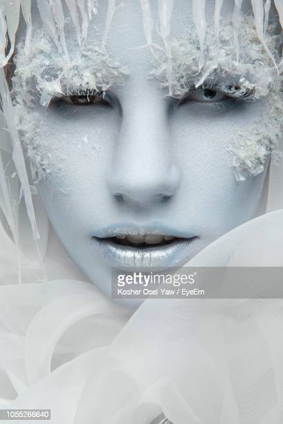 close-up portrait of young woman with fake snow - fake snow stock pictures, royalty-free photos & images