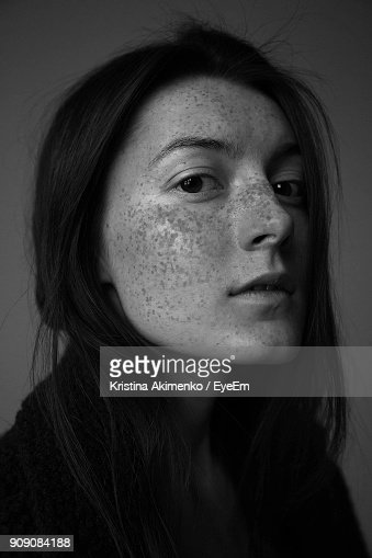 Close-Up Portrait Of Young Woman With Freckles