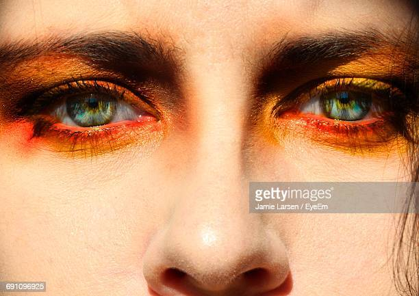 close-up portrait of young woman with orange eyeshadow - orange farbe stock-fotos und bilder