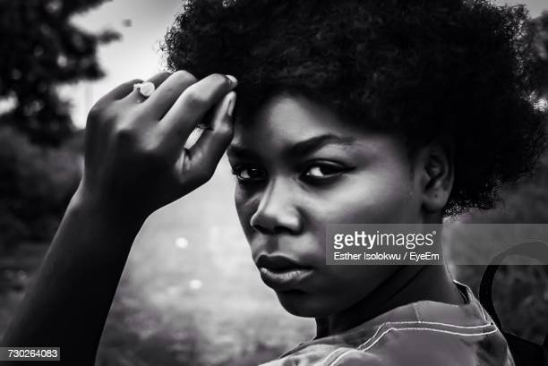 close-up portrait of young woman with short hair - nigerian girls stock photos and pictures