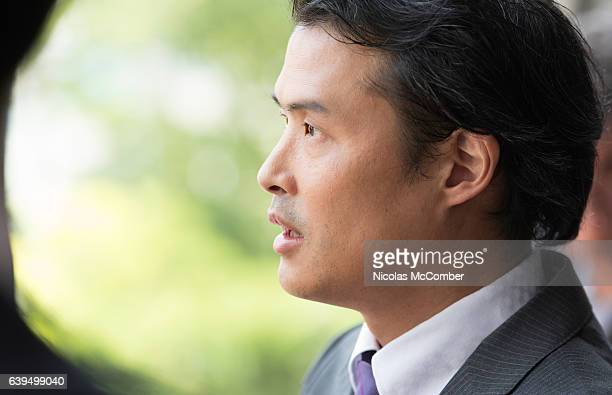 Close-up profile of Japanese middle aged businessman surprised