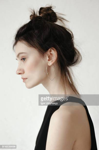 Close-up profile of pensive young woman looking away