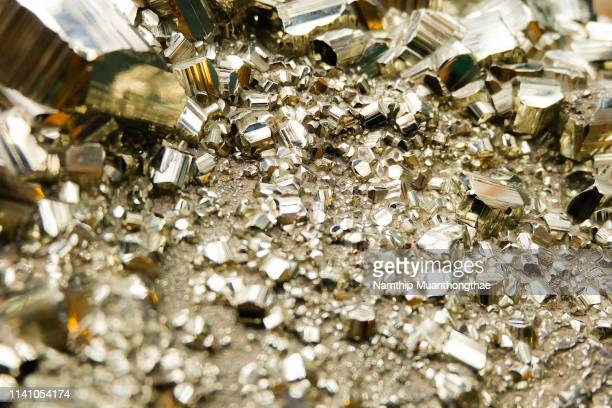 close-up pyrite cystal or fool's gold - isometric projection stock photos and pictures
