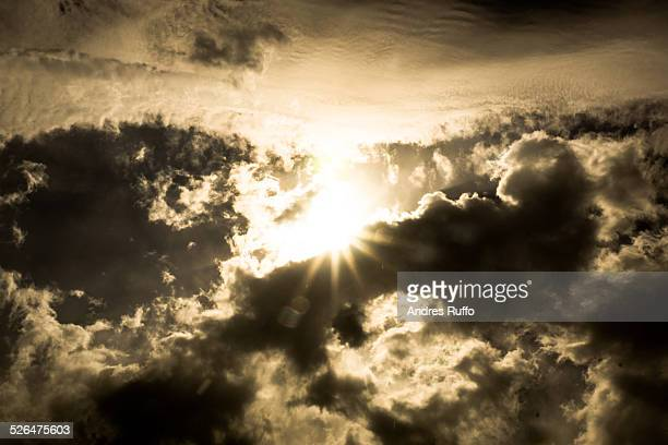 close-up rays of light breaking through the clouds - andres ruffo bildbanksfoton och bilder