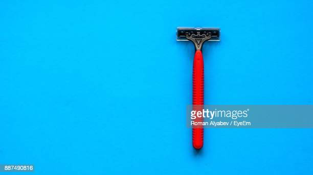 Close-Up Razor Over Blue Background