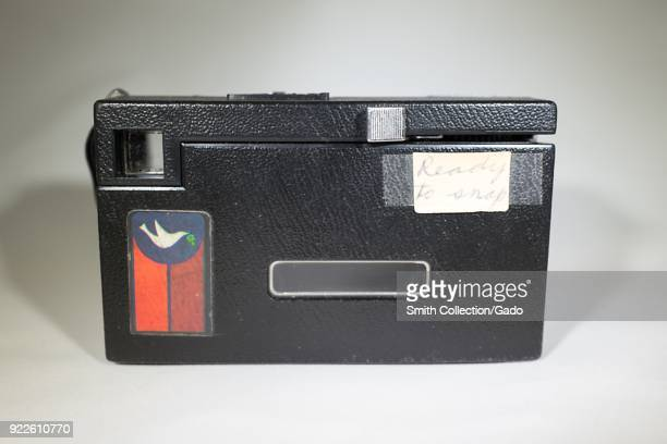 Closeup rear view of a Kodak Instamatic X15 camera popular in the 1970s with a personalized decal showing a dove carrying an olive branch February 5...
