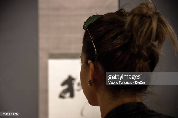 close-up rear view of woman with hair bun - one young woman only stock pictures, royalty-free photos & images