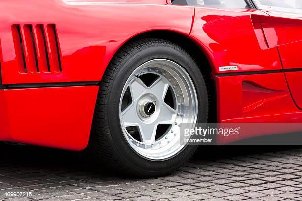 Closeup red Ferrari F40 alloy wheel