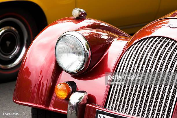closeup red morgan car headlight and radiator grille - scarlett morgan stock photos and pictures