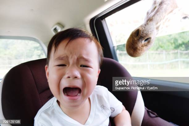 Close-Up Screaming Baby Boy In Car