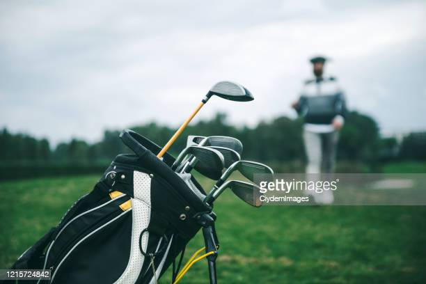 close-up shot of a golf bag in a golf course - golf club stock pictures, royalty-free photos & images