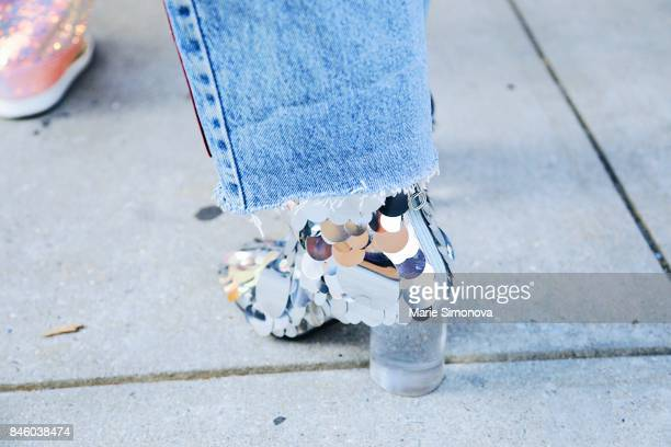 Closeup shot of a guest wearing sequin shoes during New York Fashion Week on September 11 2017 in New York City